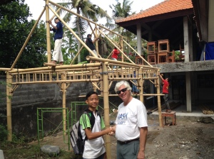 Eco Club President Kawenuh with Dave as the Eco Club Headquarters and  plastic trash storage building is constructed
